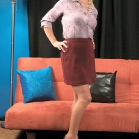 Mature blonde MILF Andi Roxxx shows her great legs in a side-split skirt