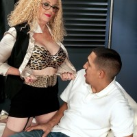 Mature therapist Charlie sports crimped blonde hair while seducing a client