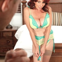 Mature redhead Karen Kougar models 3 pieced lingerie paired with sheer nylons