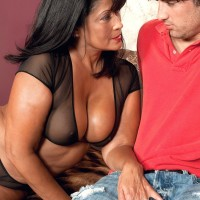 Hot older MILF Lani Maru puts the moves on a boy in sheer lingerie and hosiery