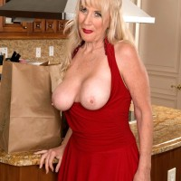 Gorgeous 60+ blonde MILF Summeran Winters looses her nice tits from a dress