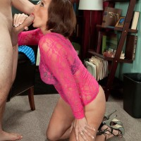 Mature MILF Yasmine Beale gets on her knees to give a younger guy a blowjob
