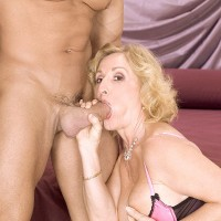 Old blonde woman Cee Cee gags on her young lover's cock while giving him head