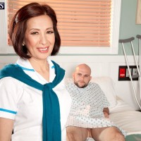 Mature Asian nurse Kim Anh stroking big dick in hospital