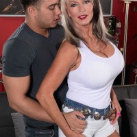 Busty granny Sally D'Angelo unleashes huge hooters
