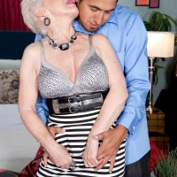 Busty granny Jewel flashes big saggy boobs and gives younger man a blowjob