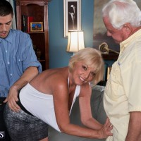 Curvy blonde granny Scarlet Andrews exposing tits for stud while cuckold husband watches