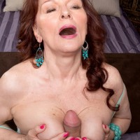 Busty mature lady Katherine Merlot giving titjob to big cock