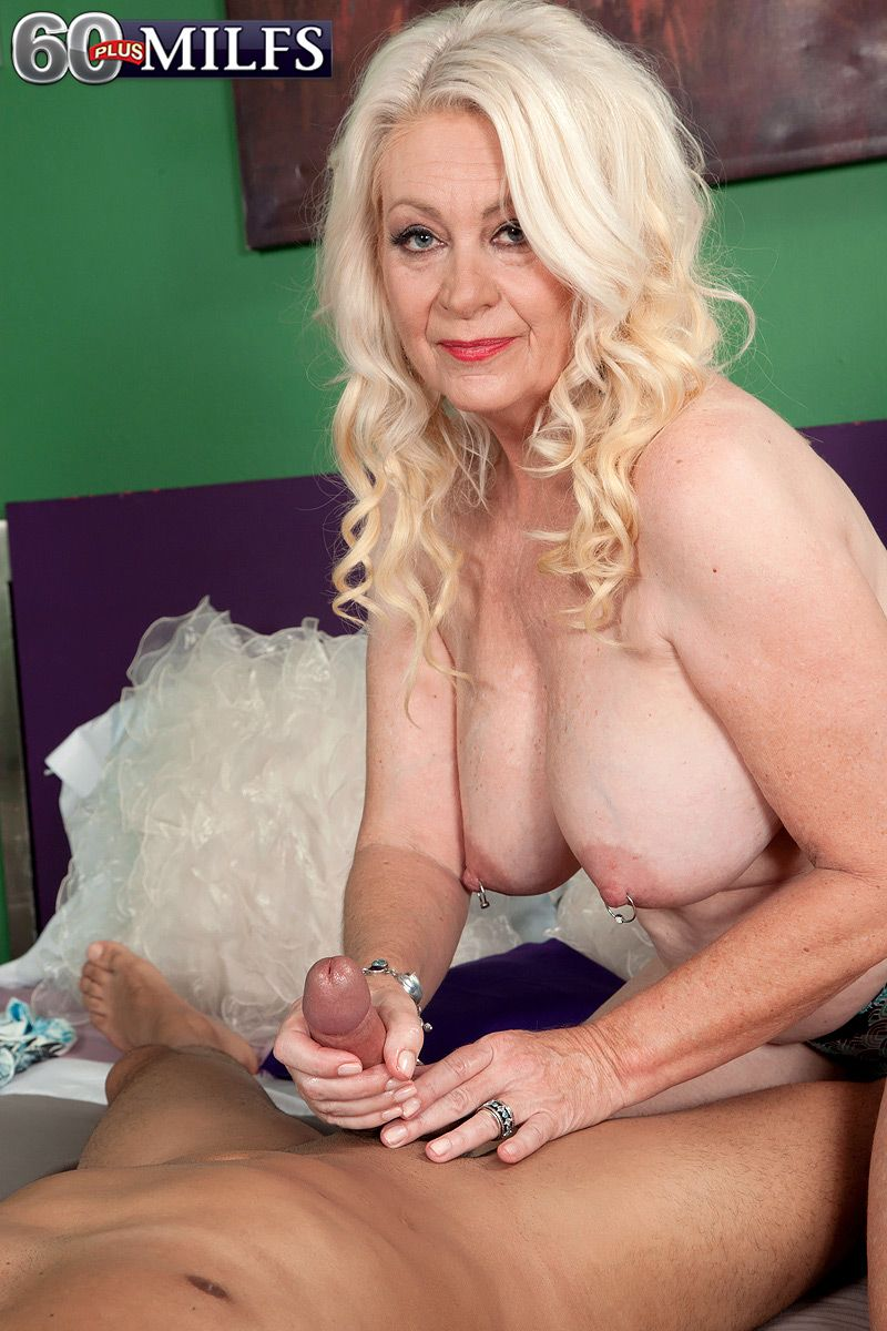 Older blonde woman Angelique DuBois giving younger man handjob and BJ