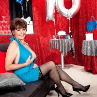 Over 60 MILF Bea Cummins posing solo in blue dress and hose