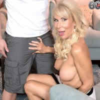 Busty blonde MILF over 60 Erica Lauren has granny pussy licked by younger man