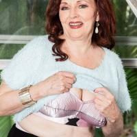 Mature pornstar Katherine Merlot flashing her natural tits to younger man