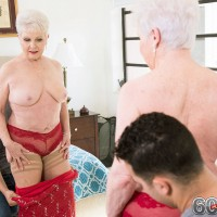 Hot granny Jewel poses in pantyhose and dress before giving blowjob to young stud