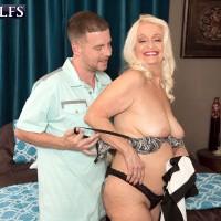 Big bottomed granny Vikki Vaughn baring ass and having saggy tits fondled