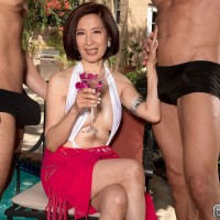 Busty Asian MILF over 60 Kim Anh sucks and fucks 2 studs outdoors by the pool
