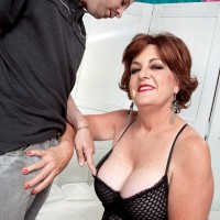 Busty over 60 housewife Gabriella LaMay fondling big tits in mesh bodystocking