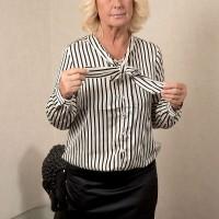 Blonde over 60 granny Regi stripping naked for hot oil massage and cunt fingering