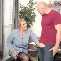 Sexy 60 plus granny Alice jerking off cock in office in black stockings
