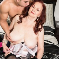 Older gal Silva Foxx gives 2 guys blowjobs in front of her cuckold husband
