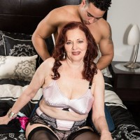 Mature redhead Katherine Merlot having large natural tits exposed by young stud