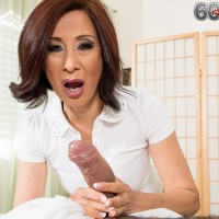 60 plus MILF Kim Anh baring natural mature tits while jerking off thick cock