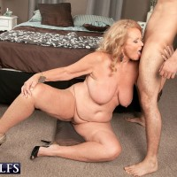 Busty over 60 blonde granny Alice taking doggystyle fucking over top of desk