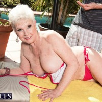 Over 60 granny Jewel getting fucked from behind by younger stud outdoors