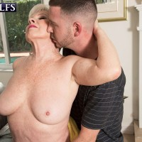 Stocking and garter adorned blonde MILF over 60 Phoenix Skye baring large tits