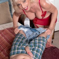 Aged pornstar Scarlet Andrews giving a titjob to a long penis