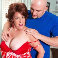Busty redhead granny Gabriella LaMay having mature pussy licked out