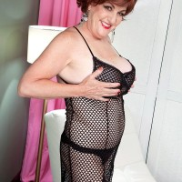 Busty older woman Gabriella LaMay letting huge juggs escape from mesh dress