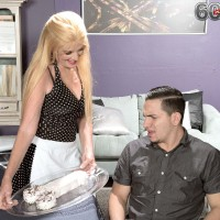 Blonde granny in maid uniform unlooses big cock for CFNM handjob action