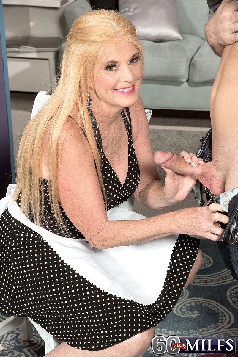 blonde granny in maid uniform unlooses big cock for cfnm handjob