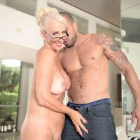 Busty 60 MILF in glasses Madison Milstar attracts cock love with huge hooters