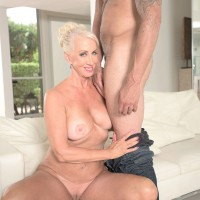 Redheaded granny with large all natural tits flashing younger man for interracial sex