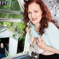 Older redhead model Katherine Merlot using large tits to seduce young man