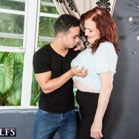Older redhead model Katherine Merlot using large tits to seduce young man