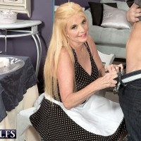 Dressed light-haired over sixty MILF Charlie giving CFNM hand job to giant sausage