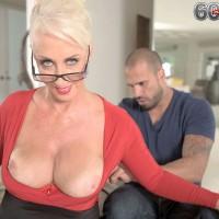 Glasses adorned 60 MILF Madison Milstar letting big mature tits free