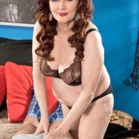 Redhead 60 MILF Katherine Merlot showing off sexy older lady legs in lingerie