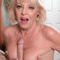 Dressed grandma Mona seducing junior guy by giving his huge cock fellatio