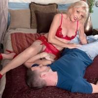 Lingerie and hose adorned 60+ MILF model Scarlet Andrews tit fucking dick