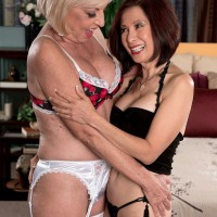 Lingerie clad 60 plus MILFs Scarlet Andrews and Kim Anh tongue kissing