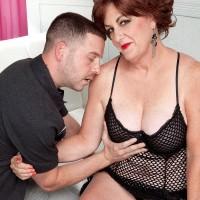 Busty redheaded mature lady Gabriella LaMay seducing man in mesh bodysuit