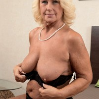 Blonde MILF over 60 Regi stripping naked for hot oil massage