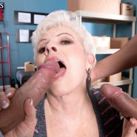 Horny over 60 lady Jewel sucking off two large cocks at same time in warehouse
