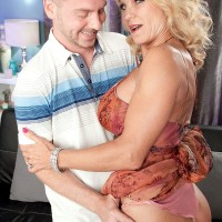 Buxom 0ver 60 MILF Sally D'Angelo giving blowjob and titjob to long cock