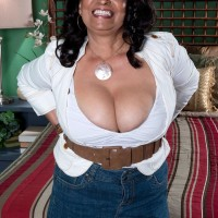 Denim skirt attired 60plusmilf.com model Rochelle Sweet having big tits exposed