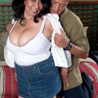 Denim skirt attired 60plusmilf.com model Rochelle Sweet having big tits exposed