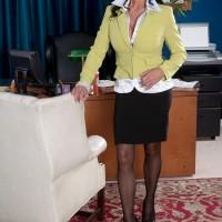 Busty 60 plus MILF Rita Daniels seducing sex in skirt and nylons